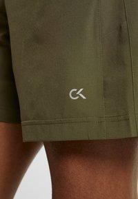 Calvin Klein Performance - SHORT - Sports shorts - green - 6