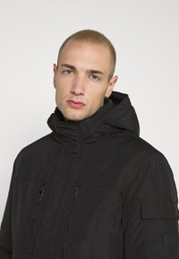 Jack & Jones - JJFERGUS JACKET - Regenjas - black - 3