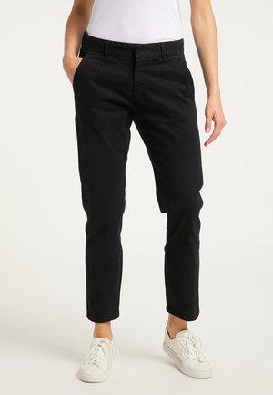 Pantalones chinos - schwarz