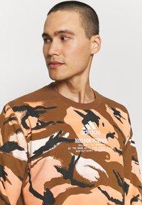 adidas Performance - ZNE CREW - Sweatshirt - brown - 3
