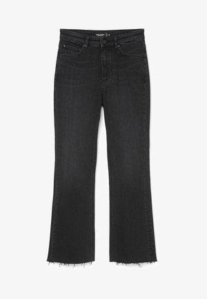 IDA KICK  - Flared Jeans - multi/black enzyme