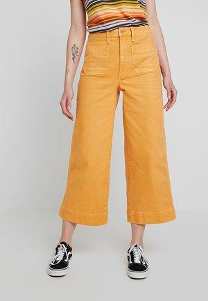 EMMETT PATCH POCKETS - Trousers - bright marigold