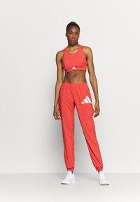 adidas Performance - BOS PANT - Pantaloni sportivi - crered/white - 1