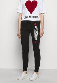Love Moschino - Spodnie treningowe - black - 0