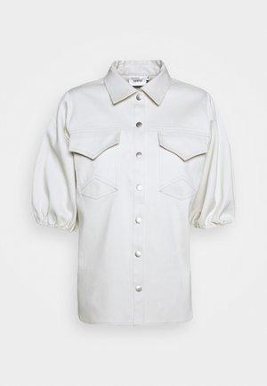 VANJO - Button-down blouse - blue blush