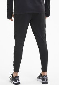 Puma - Tracksuit bottoms -  black - 2