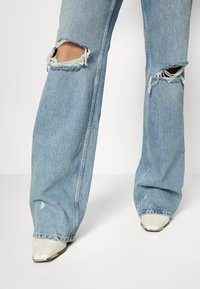 ONLY Tall - ONLINC DREA LIFE JUMPSUIT TAL - Jumpsuit - light blue denim - 6