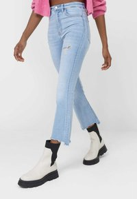 Stradivarius - Slim fit jeans - light blue - 0