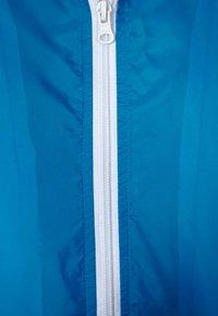 Urban Classics - Light jacket - turquoise/white - 3