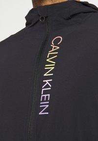 Calvin Klein Performance - PRIDE WINDJACKET - Training jacket - black - 5