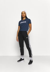 adidas Performance - T-shirts print - crname/white - 1