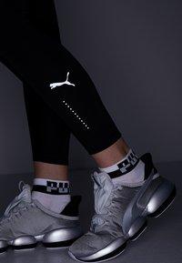 Puma - EVOSTRIPE LEGGINGS - Collant - black - 6