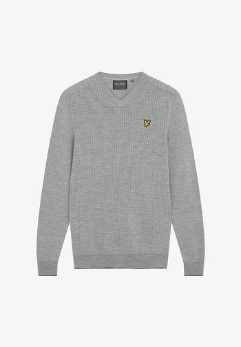 Stickad tröja - pebble