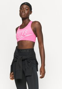 Nike Performance - FUTURA BRA - Sujetadores deportivos con sujeción media - pinksicle/white - 4