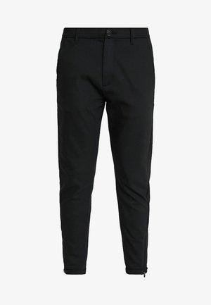 PISA Small Dot - Trousers - black