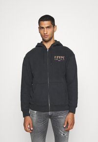 Levi's® - RELAXED GRAPHIC ZIPUP - Zip-up hoodie - jet black - 0