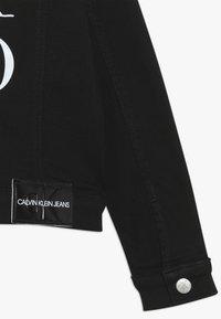Calvin Klein Jeans - UNISEX TRUCKER - Džínová bunda - black - 2