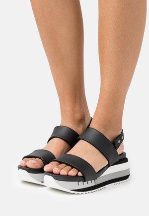 CHARLOTTE - Sandalen met plateauzool - black