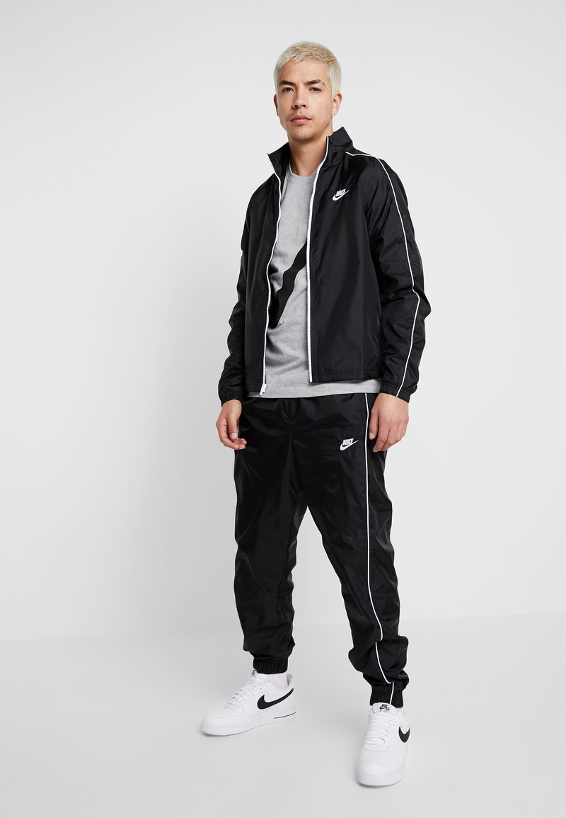 Nike Sportswear - SUIT BASIC - Tracksuit - black/white