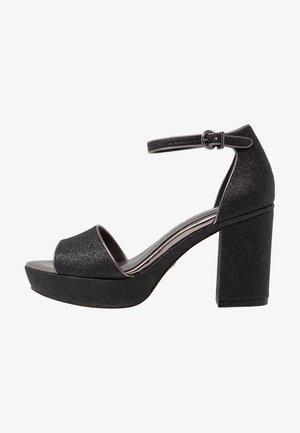 Korolliset sandaalit - black glam