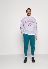 Nike Sportswear - TONE - Tracksuit bottoms - dark teal green/blustery - 1
