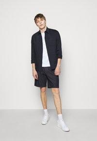Emporio Armani - Denim shorts - dark blue - 1