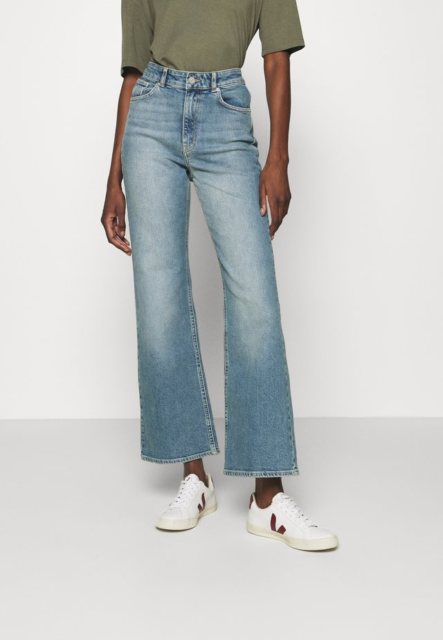 CINDY - Flared jeans - blue denim
