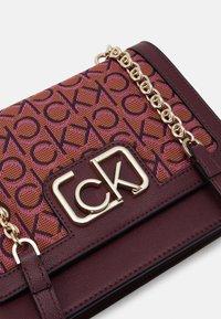 Calvin Klein - FLAP SHOULDER BAG - Across body bag - brown - 3