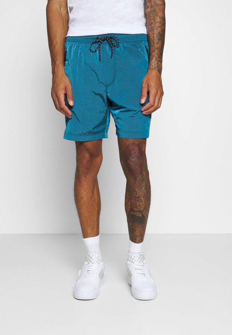 American Eagle - IRIDESCENT ALL DAY  - Tracksuit bottoms - bright blue