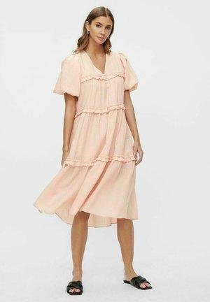 Korte jurk - apricot cream