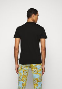 Versace Jeans Couture - T-shirt con stampa - black - 2