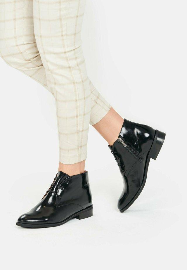 TILDA - Lace-up ankle boots - black