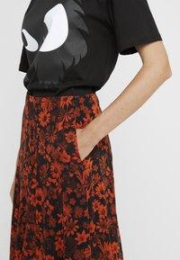 McQ Alexander McQueen - SEAMED GODET SKIRT - A-line skirt - darkest black/orange - 5