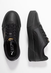 Puma - CARINA  - Sneakers laag - black/team gold