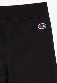 Champion - LOGO RIB CUFF  - Spodnie treningowe - black - 4