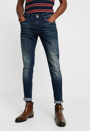 DAN - Jeans Tapered Fit - dark blue