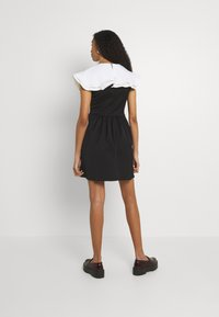 Sister Jane - POSTCARD CONFESSIONS MINI DRESS - Day dress - black - 2