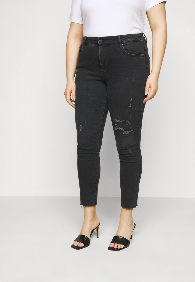 ONLY Carmakoma - CARRUSH LIFE REG SK ANK RAW - Jeans Skinny Fit - black denim