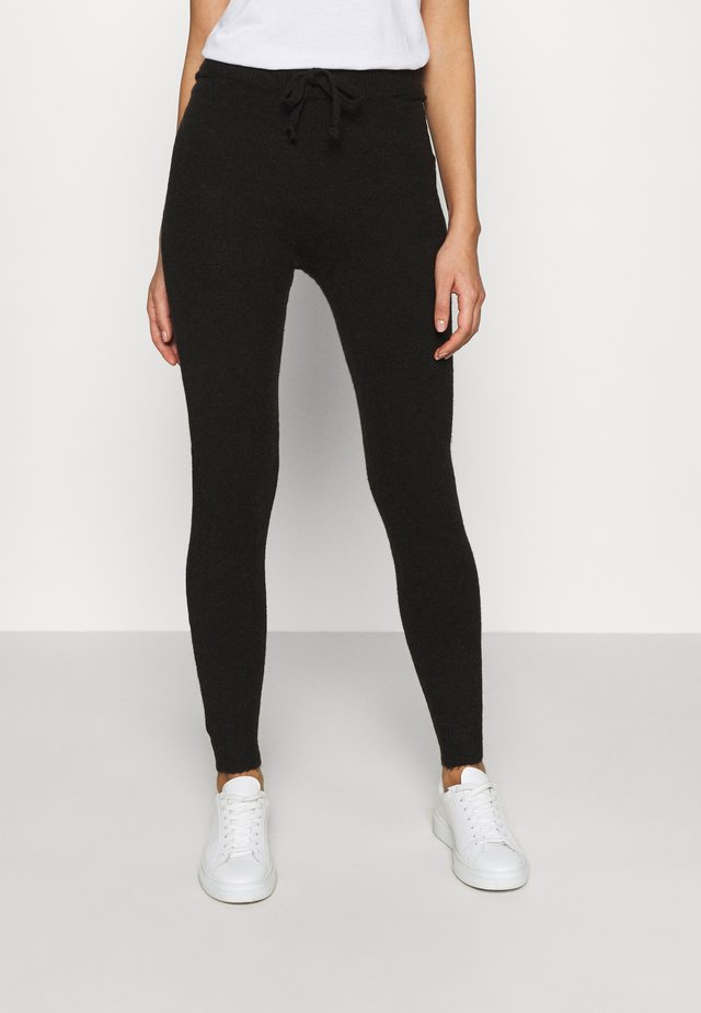 SANDRA TROUSERS - Verryttelyhousut - black