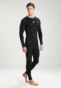 adidas Performance - Camiseta de deporte - black - 1