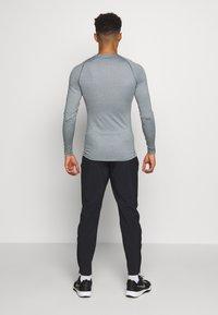 Nike Performance - Sports shirt - smoke grey/light smoke grey/black - 2