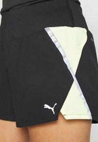 Puma - RUN LITE SHORT - Pantalón corto de deporte - black/fizzy yellow - 6