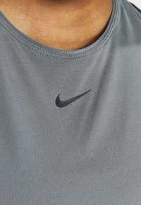 Nike Performance - TANK ALL OVER  - Camiseta de deporte - smoke grey/black - 4