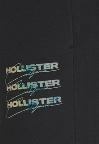 Hollister Co. - SCRIPT PRINT JOGGER - Tracksuit bottoms - black - 4