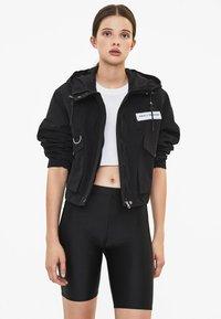 Bershka - MIT KAPUZE - Outdoor jacket - black - 0