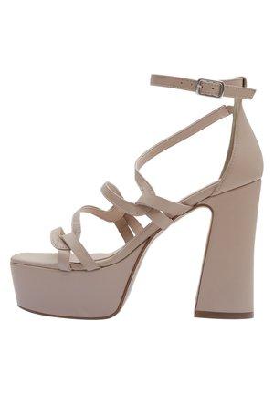 High heeled sandals - nude