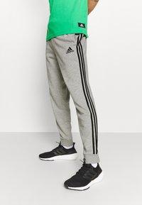 adidas Performance - Tracksuit bottoms - medium grey heather/black - 3