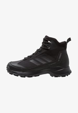 TERREX HERON MID WINTER HIKING SHOES - Trekingové boty - core black/grey four