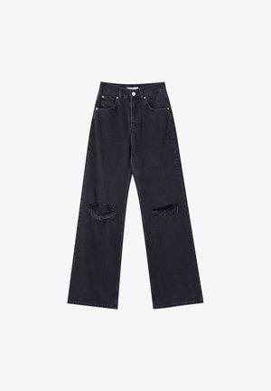 MIT HOHEM BUND - Flared Jeans - black