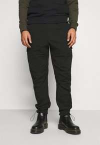 Calvin Klein Jeans - TECHNICAL - Cargo trousers - black - 0